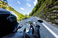 Motorcycle driver riding in Alpine highway, handlebars view, Austria, Europe. Motorcycle driver riding in Alpine highway, handlebars view, Austria, central Stock Photos