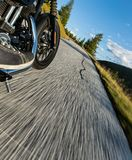 Motorcycle driver riding in Alpine highway, Nockalmstrasse, Austria, Europe. royalty free stock image