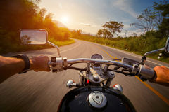 Motorcycle. Driver riding motorcycle on the empty asphalt road stock photo