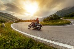 Free Motorcycle Driver Riding In Alpine Landscape Stock Images - 156172864