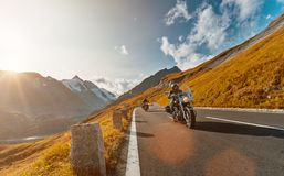 Motorcycle driver riding japanese high power cruiser in Alpine highway on famous Hochalpenstrasse, Austria. stock photography