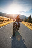 Motorcycle driver riding on motorway Stock Images
