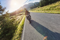 Motorcycle driver riding on motorway Royalty Free Stock Photography