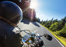 Motorcycle driver riding on motorway Stock Photography