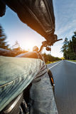 Motorcycle driver riding on motorway Stock Photo
