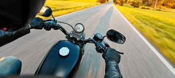 Motorcycle driver riding on motorway Stock Photos