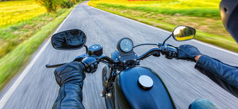 Motorcycle driver riding on motorway royalty free stock images