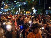 Motorcycle drivers in Ho Chi Minh City Vietnam. Unidentified men and women drive their motorcycles during the Tet Lunar New Year celebrations on January 18, 2008 Royalty Free Stock Image