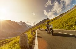 Motorcycle drivers riding in Alpine highway on famous Hochalpenstrasse, Austria, Europe. stock photos