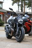 Motorcycle Ducati Diavel matt black. Front view on cloudy day royalty free stock photography