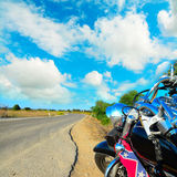 Motorcycle on the edge of the road Stock Images
