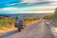Motorcycle on the edge of the road Royalty Free Stock Images