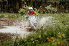 Motorcycle enduro crosses puddles Stock Images