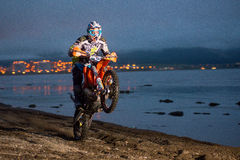 Motorcycle Enduro riding wheelies on the beach Stock Photos