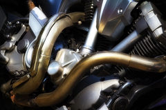 Motorcycle Engine. Metalic background with exhaust pipes Royalty Free Stock Image