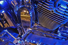 Motorcycle Engine. Lit with blue neon lights Stock Image