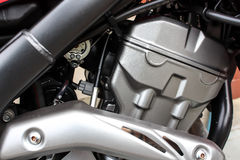 Motorcycle engine. Clean engine of motorbike in the street Stock Photography