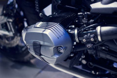 Motorcycle engine close-up on dark background Stock Photo