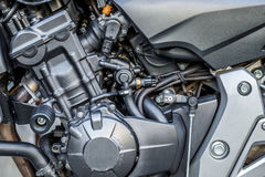 Motorcycle engine close-up detail background Stock Photos
