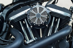 Motorcycle engine close-up detail on wall background Stock Photo
