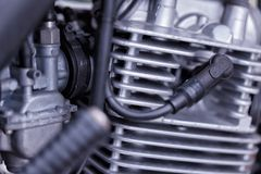 Motorcycle engine of 125 cubic centimeters. And four times royalty free stock photo