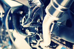 Motorcycle engine with model high heel boots Stock Images