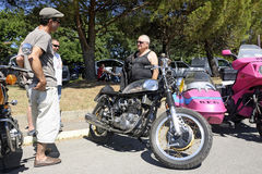 Motorcycle enthusiasts group around an old triumph triton Royalty Free Stock Photography