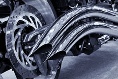 Motorcycle exhaust. A rear view of a motorcycle with the focus on the chrome exhaust Royalty Free Stock Photos