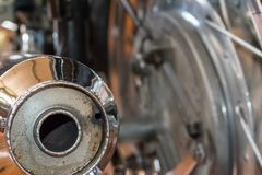 Motorcycle exhaust. Exhaust pipe with rusty bits on an old motorcycle Stock Photography