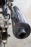 Motorcycle exhaust pipe. A silver motorcycle exhaust pipe Stock Photo