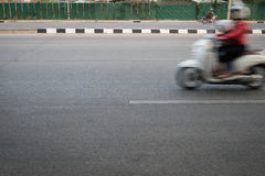 Motorcycle fast motion blurred driving Stock Photo