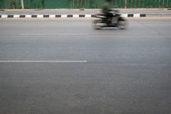 Motorcycle fast motion blurred driving Stock Photos