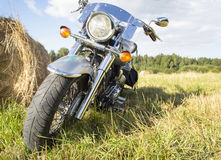 Motorcycle on the field outside the city Royalty Free Stock Images