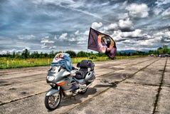 Motorcycle with flag. MW motorcycle with flag under sky with clouds, HDR .Uzhgorod bikers show.Ukraine royalty free stock image