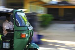 Motorcycle flashing in the street. Street scenery of Sri Lanka.  A motorcycle is flashing in the street Royalty Free Stock Photo