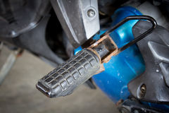 Motorcycle foot-plate Stock Images