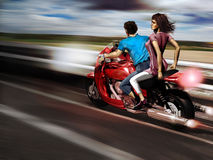 Motorcycle freedom. A couple on a motorcycle. he drives while she  enjoys the sensation of freedom which produces the air caused by the speed Stock Photography