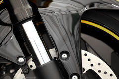 Motorcycle front suspension. Color detail of the front suspension of a motorcycle Royalty Free Stock Photos