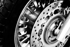 motorcycle front wheel in black and white  Royalty Free Stock Images