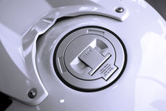 Motorcycle fuel tank. Motorcycle lid fuel tank in white Royalty Free Stock Photography