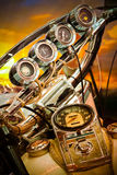 Motorcycle Gauge. S on a vintage motorbike with sunset background Royalty Free Stock Images
