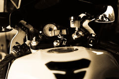 Motorcycle Gauges. A photograph of a motorcycle ready to race, gauges lid up royalty free stock images