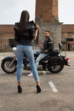 Motorcycle Girl. Girl teasing guy on bike Stock Photography