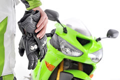 Motorcycle gloves with carbon and bike Royalty Free Stock Photos