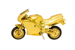 Motorcycle golden toy isolated on white Royalty Free Stock Images