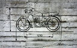 Motorcycle graffiti. Poland, Kielce, Zagnanska Street, 19th March 2010, the city wall with  painted dimensions flow-sheet of motorbike Royalty Free Stock Photography