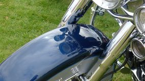 Motorcycle and green grass Royalty Free Stock Images