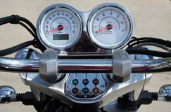 Motorcycle handlebar controls. Including speedometer and tachometer stock photography