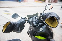 Motorcycle handlebars with heat resistant gloves. Equipment Royalty Free Stock Images