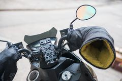 Motorcycle handlebars with heat resistant gloves. Equipment Stock Photography